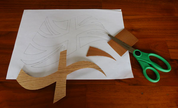 Draw your picture and cut out veneer shapes